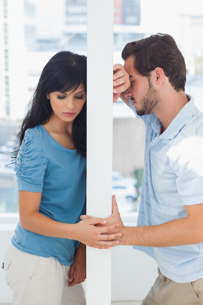 Couple,Are,Separated,By,White,Wall,Having,Relationship,Problems