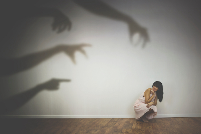 Woman,Frightened,By,The,Shadows,Of,Hands,Of,Demons