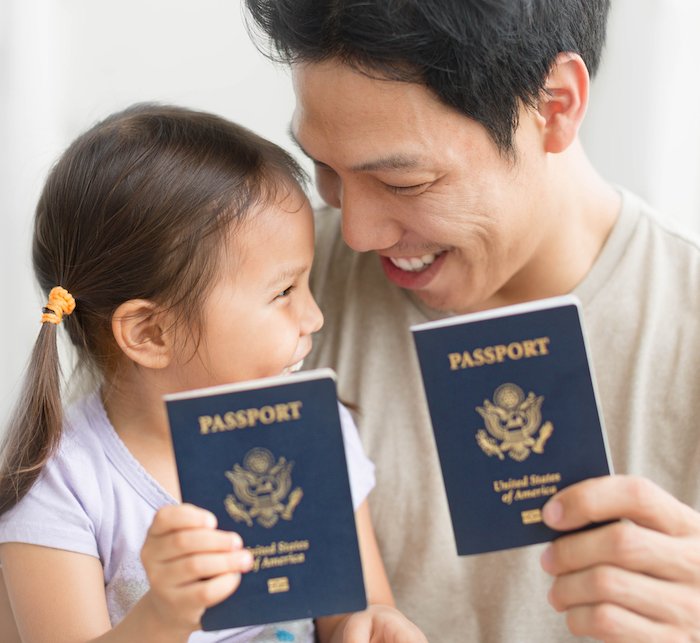 Man,And,His,Daughter,Are,Happy,To,Receive,Us,Passports.