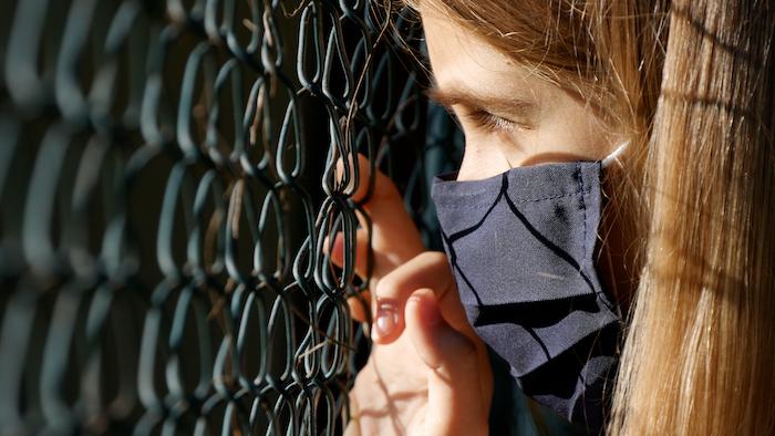 Sad,Child,Wears,Protective,Mask,Due,Coronavirus,Pandemic,,Sick,Unhappy